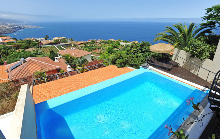 Holiday villa with private pool and sea views from the terrace with sun loungers in Tenerife