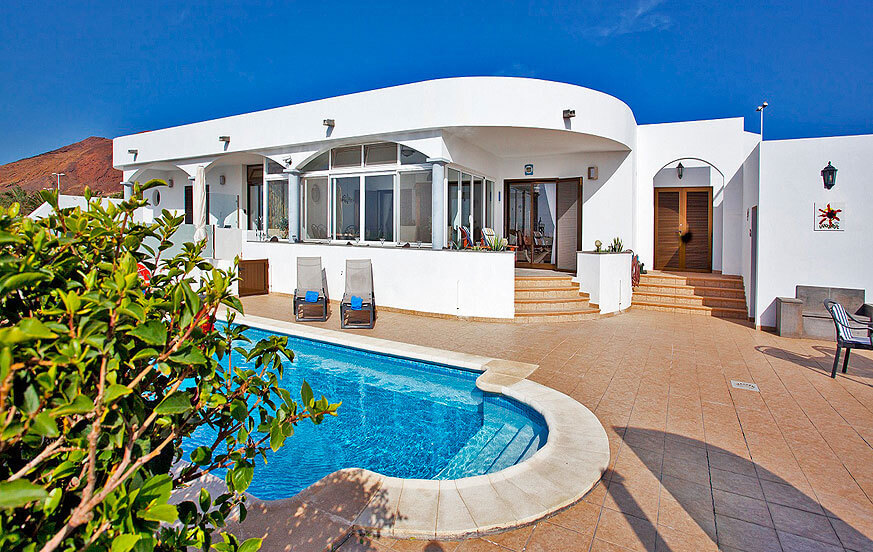 Stylish holiday villa with private pool and winter garden with views to the sea on Lanzarote