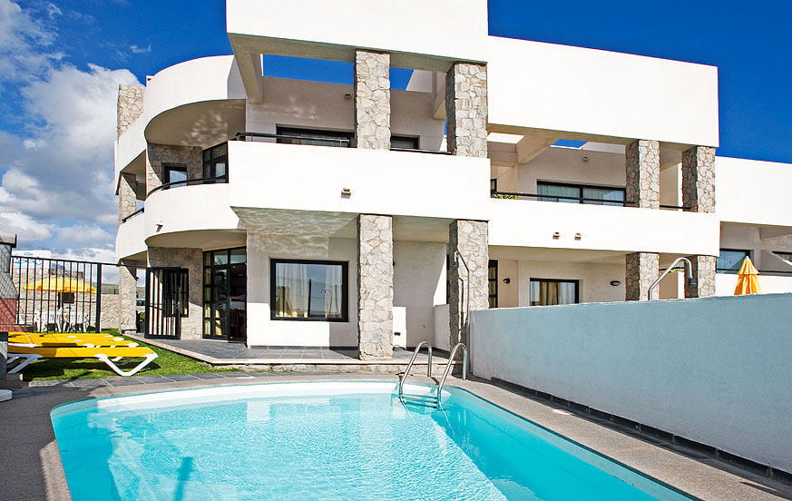 Complex of five villas located in Puerto Rico in the south of the island with incredible views to the sea and the mountains