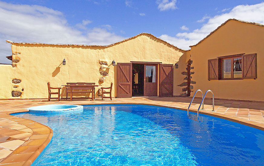 Beautiful rustic-style holiday home on a stored finca with communal pool and located in the center of the island