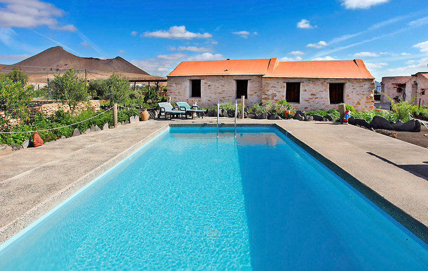 Beautiful rustic style house on a large finca with three individual houses, communal pool and fantastic views of the landscape