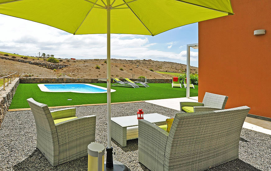 Villa for rent with large outdoor area with seating, private pool and a prime location directly at the golf course
