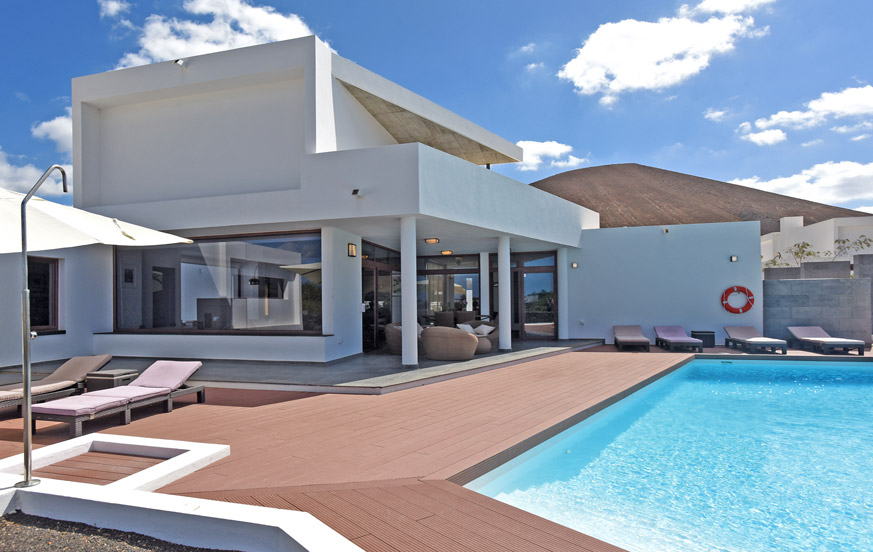 Modern three bedroom villa rental with spacious rooms, private pool and panoramic views of the volcanic landscape of Uga