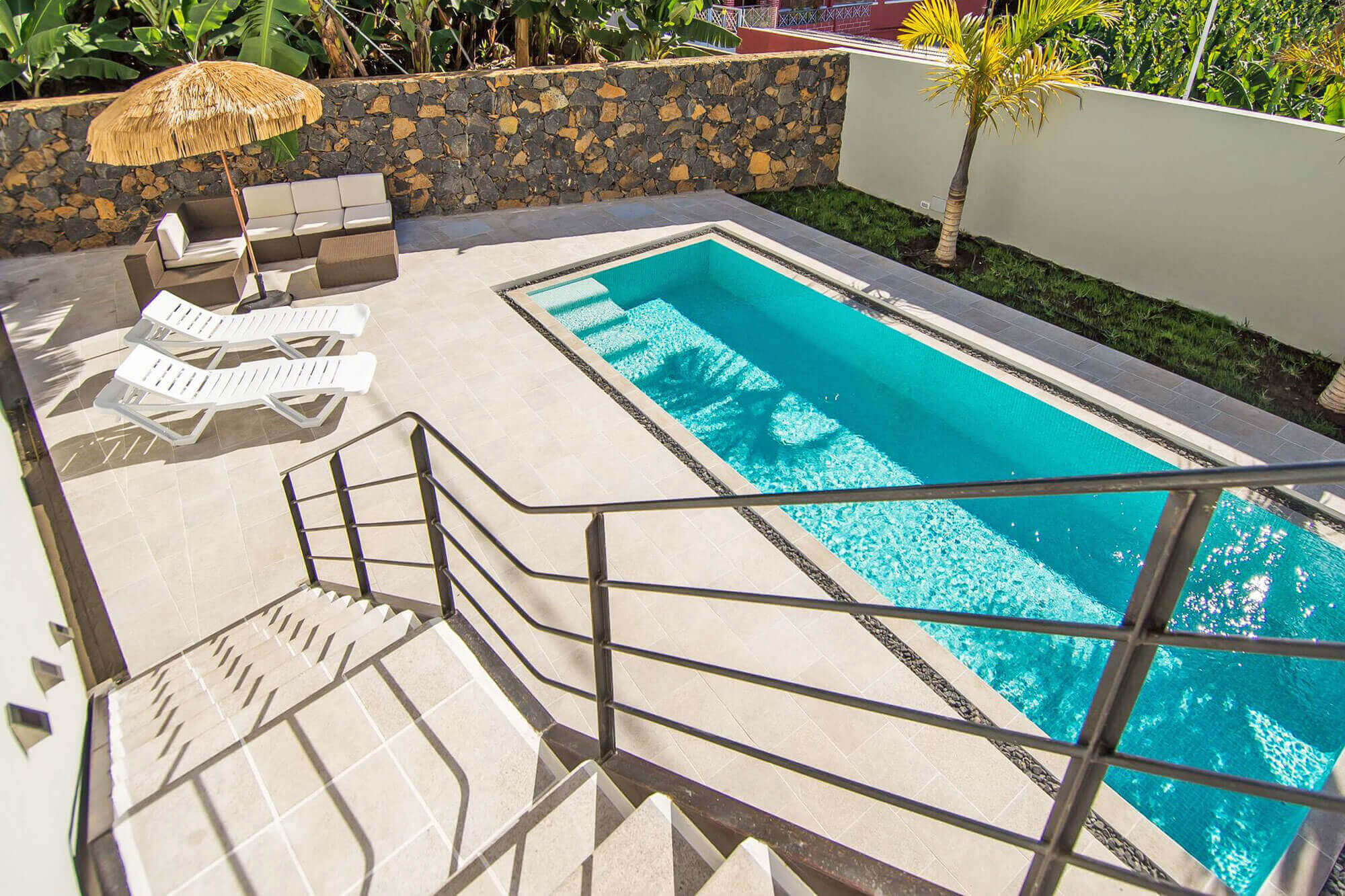 Modern holiday home on 3 floors in loft style with private pool and large roof terrace with spectacular sea views