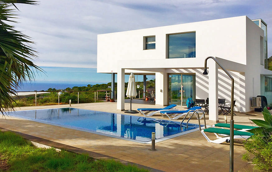 Modern architecture luxury villa with large pool and beautiful panoramic sea views