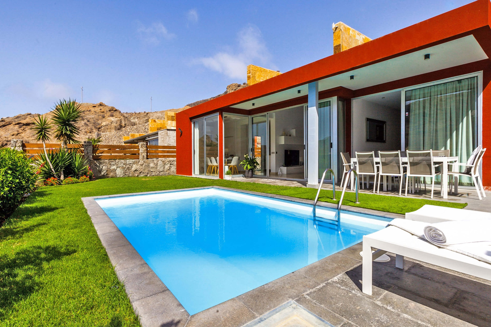 Modern open concept luxury villa with private pool overlooking the sea and mountains in the Anfi Tauro area