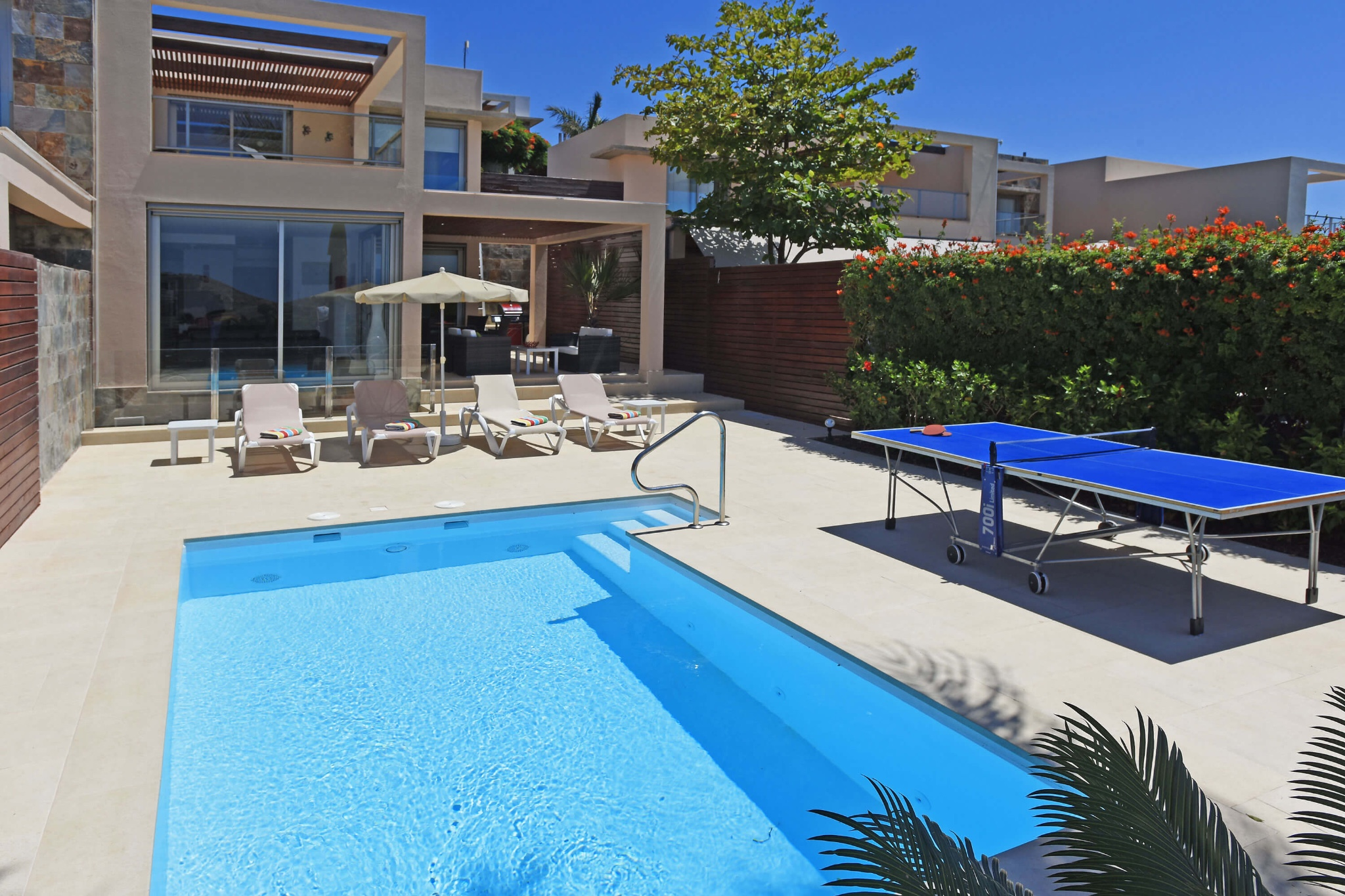 Modern two-storey villa with pleasant outdoor areas with seating area, sun loungers, table tennis and private pool