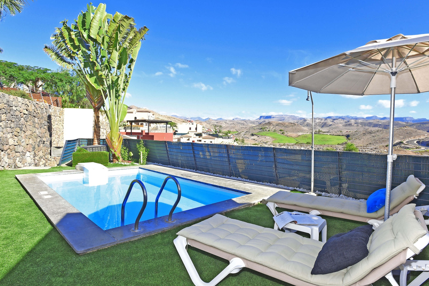 Stylish holiday home on one floor with private pool, garden and stunning views of countryside and golf course