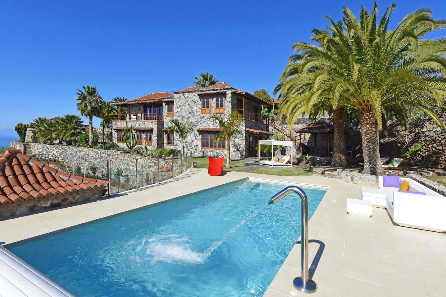 Luxurious large holiday house with a beautiful pool area, magnificent gardens and fantastic views to the sea and mountains